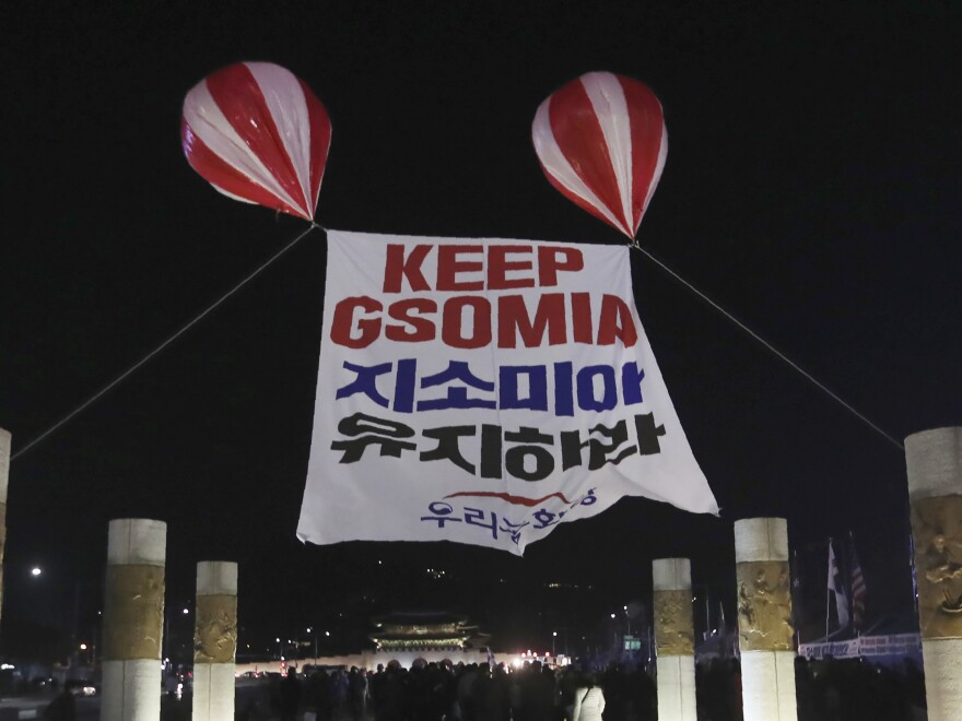 South Korea's government says it will stay in the General Security of Military Information Agreement, or GSOMIA, with Japan, reversing course hours before a midnight deadline. Here, a protest banner about the plan was on display in Seoul on Friday.
