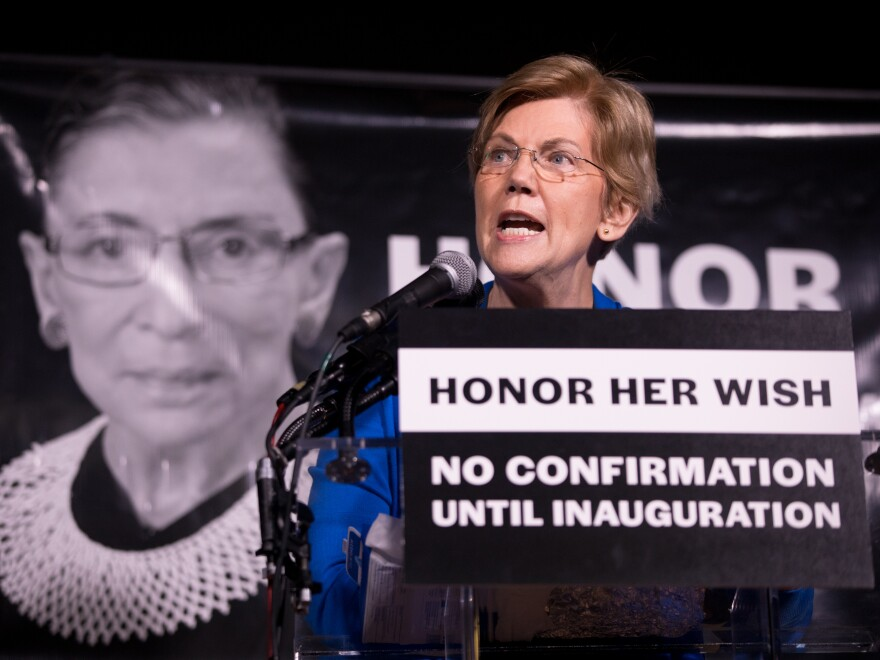 Sen. Elizabeth Warren, D-Mass., rallies the crowd of 2,500 people during a vigil Saturday night for Justice Ruth Bader Ginsburg in Washington, D.C.