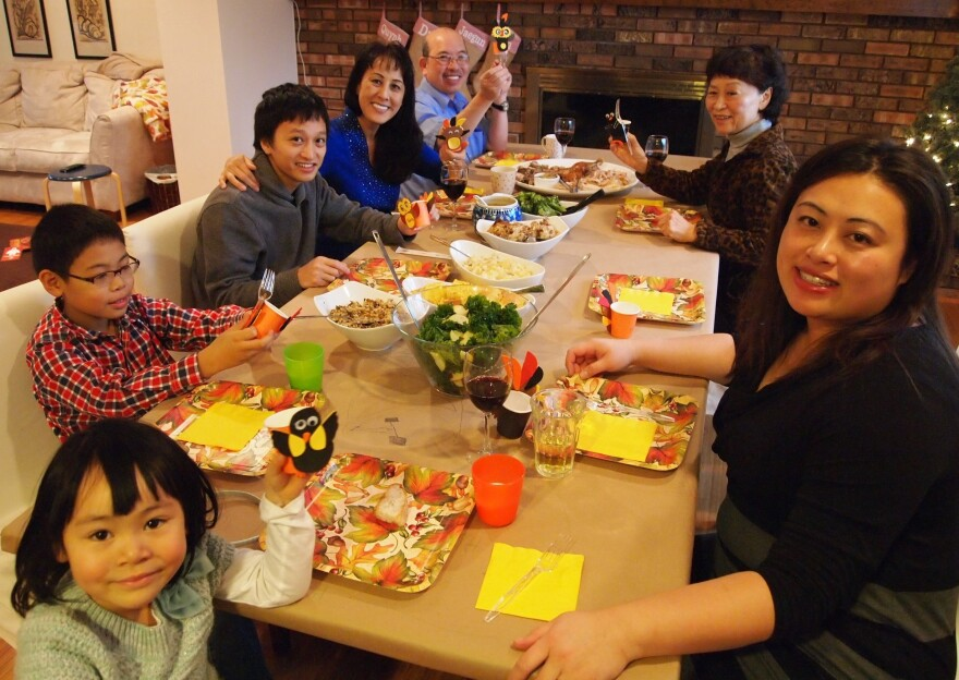 Linh Song (lower right) and Tina Lam (upper right) celebrate a family Thanksgiving in Ann Arbor, Mich, in 2014.