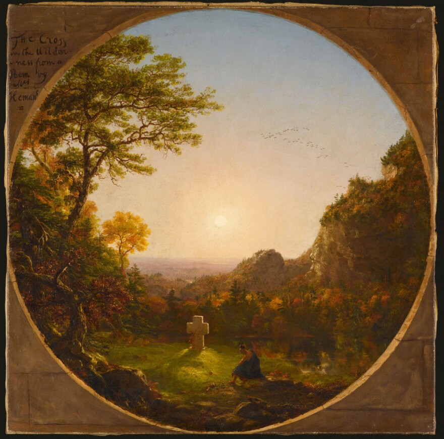 In Thomas Cole's <em>Cross in the Wilderness</em>, a Native American meditates in front of the burial cross of the pilgrim who converted him.