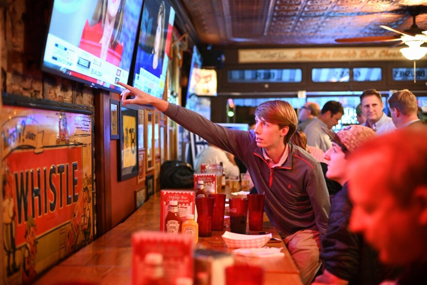 Matthew Matava, 17, and Ben Johnson, 16, watch election results roll in at U.S. Rep. Ann Wagner's watch party at the Village Bar and Grill in Des Peres. Both teens interned with the GOP over the summer, knocking on doors and making calls.