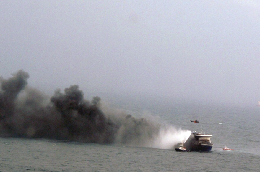 In this image provided by the Italian navy, smoke billows from the Italian-flagged Norman Atlantic after it caught fire in the Adriatic Sea on Sunday.