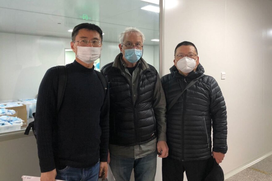 Michael Crotty (center) with Zhang Guangli (left) and Archi Liu, partners for 18 years at Golden Pacific Fashion and Design, a Shanghai curtain manufacturer that now makes masks.