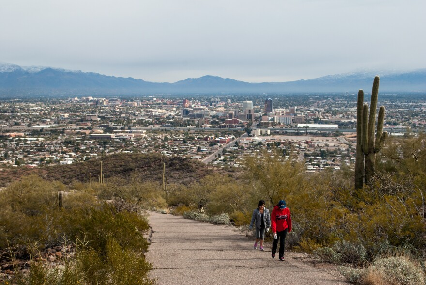 <strong></strong>Hikers climb past saguaro cacti on Tumamoc Hill, just west of downtown Tucson. The popular hiking path is trafficked by a far more diverse group of people than neighboring Saguaro National Park.