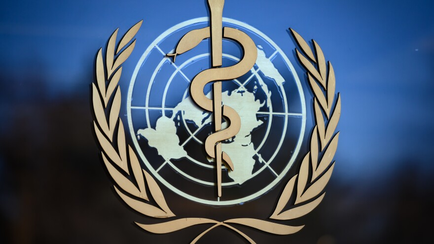 """The logo of the World Health Organization (WHO) at its headquarters in Geneva. The organization says the coronavirus is primarily transmitted """"through respiratory droplets and contact routes,"""" not airborne transmission."""