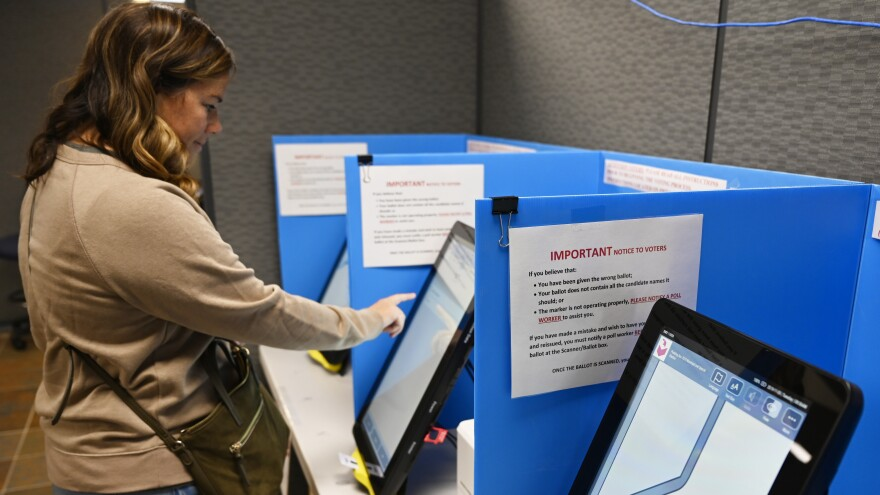 Courtney Parker votes on a new voting machine in Dallas, Ga., last November. Whereas Georgia voters statewide are expected to vote on new machines in 2020, millions of voters across the country are expected to use machines that are more than a decade old.