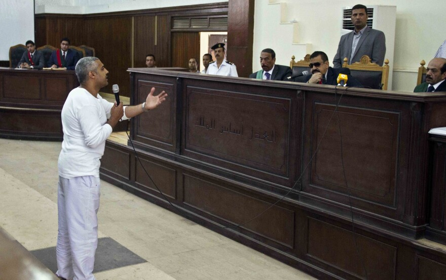 Al-Jazeera's Mohamed Fahmy pleads his case to the judge in Cairo last May. Fahmy is one of three Al-Jazeera journalists convicted of terrorism charges.