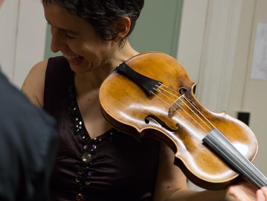 Violinist Amandine Beyer holds Mozart's own violin backstage at Boston's Jordan Hall on Monday.