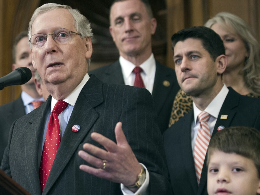 Senate Majority Leader Mitch McConnell speaks on Capitol Hill in December alongside House Speaker Paul Ryan.