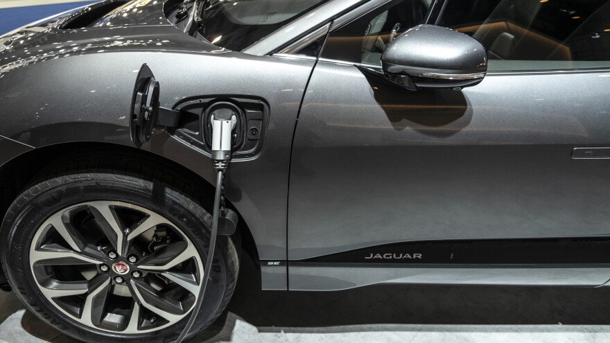A Jaguar I-Pace, the first electric vehicle from the premium carmaker, charges during an event in Barcelona, Spain, in May.