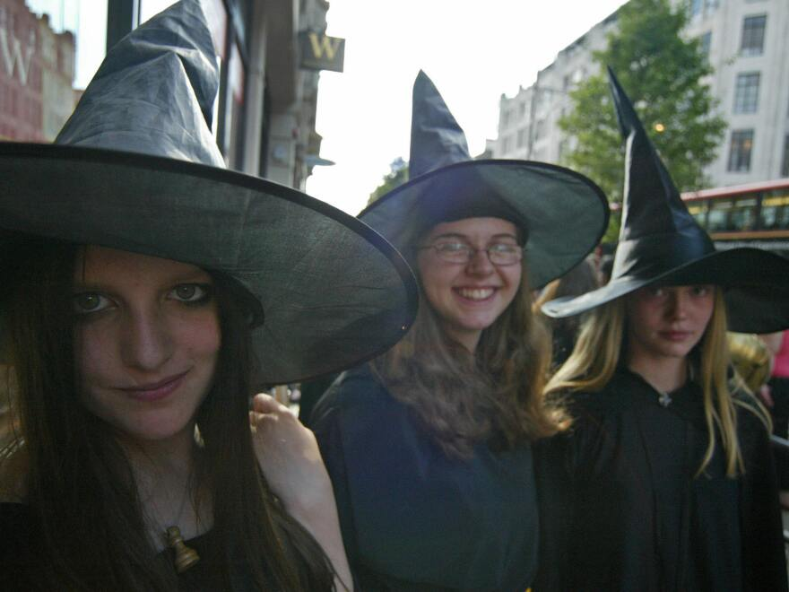 Remember the frenzy when <em>Harry Potter</em> books and movies came out? Fans may be cast under a similar spell now that J.K. Rowling has agreed to write the screenplay for a <em>Potter</em> spinoff. (This 2005 photo was taken in London when the book <em>Harry Potter and the Half-Blood Prince</em> was released.)