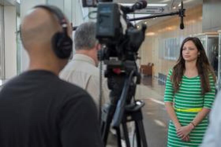 USF PA student Melissa Karaban (right) talks to WUSF University Beat reporter Mark Schreiner (center).