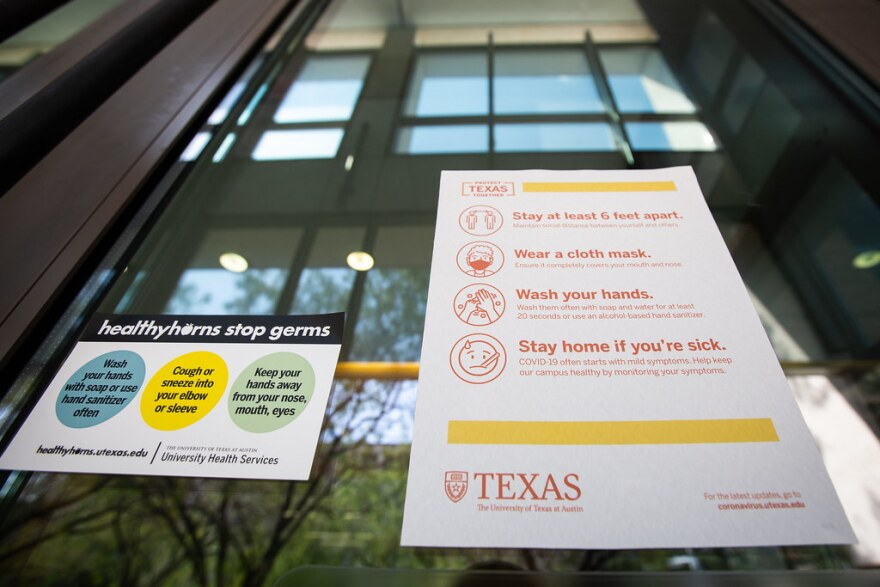 COVID-19 safety guidelines posted on the UT Austin campus on Aug. 21.