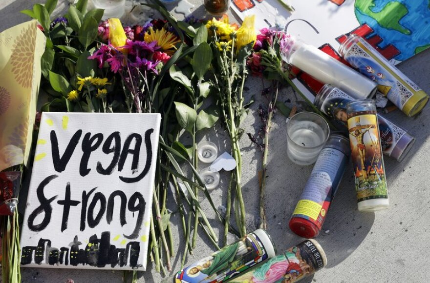 Flowers and signs are left at a makeshift memorial for the victimes of a mass shooting in Las Vegas.