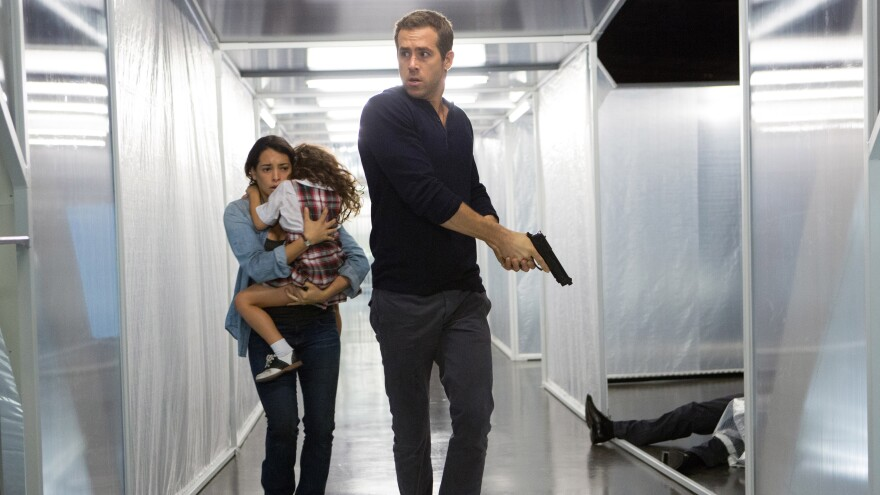 Madeline (Natalie Martinez) and daughter Anna (Jaynee-Lynne Kinchen) with Young Damian/Edward (Ryan Reynolds) in <em>Self/less.</em>