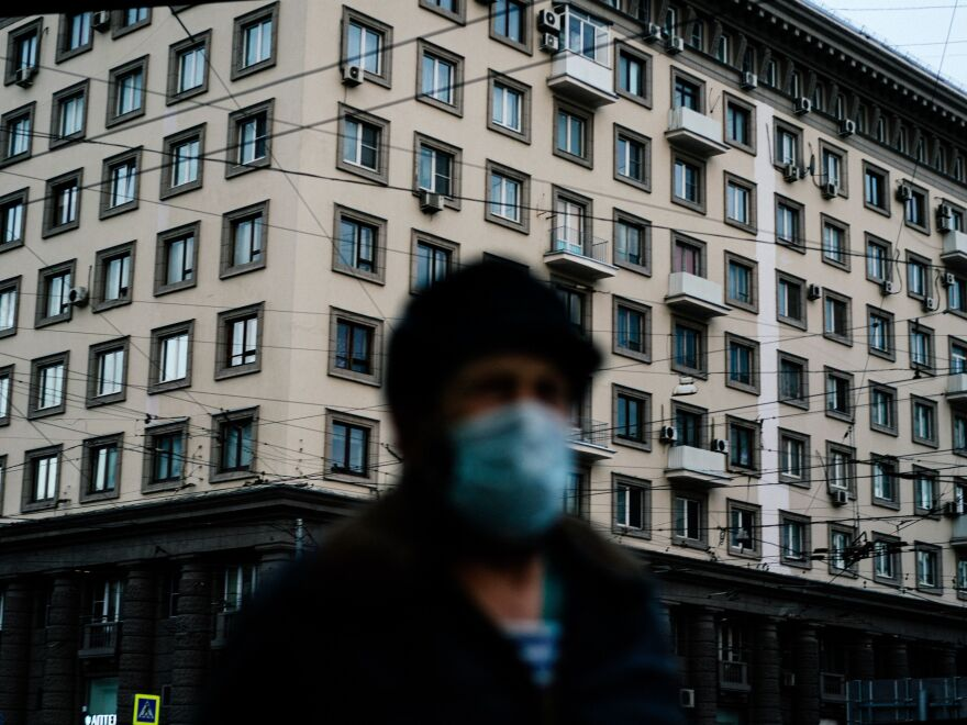 A man wearing a face mask walks in Moscow in mid-April during a strict lockdown to stop the spread of the coronavirus.
