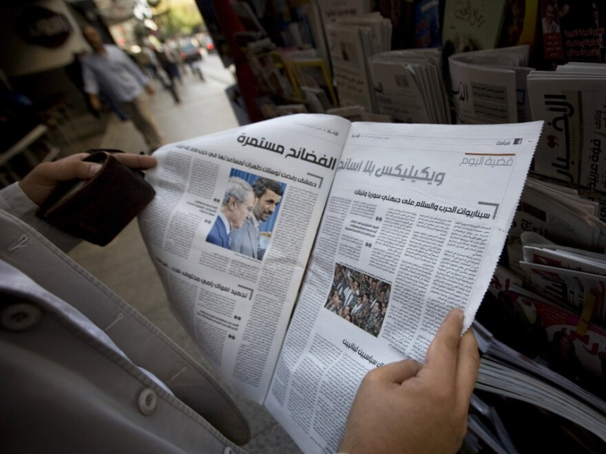 A man reads Lebanon's daily <em>Al-Akhbar</em> in Beirut. The paper is known for being close to Syria, but the regime's recent crackdown on dissenters — and lack of credible information about the protests — has strained that connection.