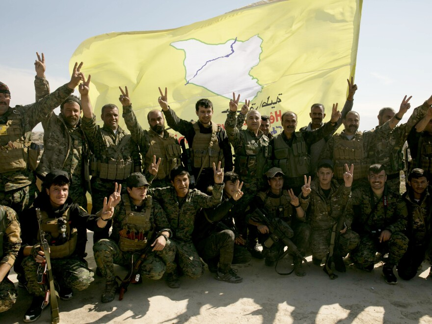 U.S.-backed Syrian Democratic Forces (SDF) fighters pose for a photo in Baghouz, Syria, in March after the SDF declared the area free of Islamic State militants.