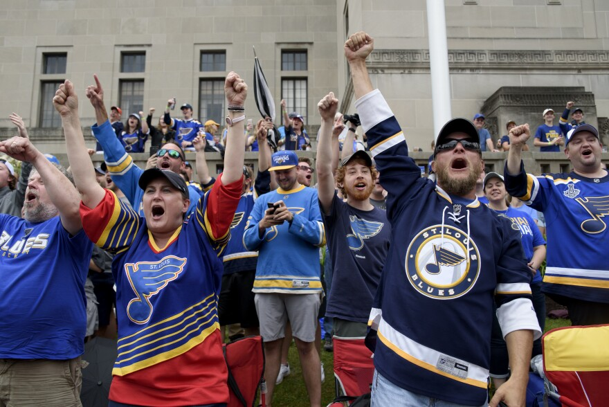 Blues fans cheer during the Blues championship parade in downtown St. Louis on Saturday. June 15, 2019