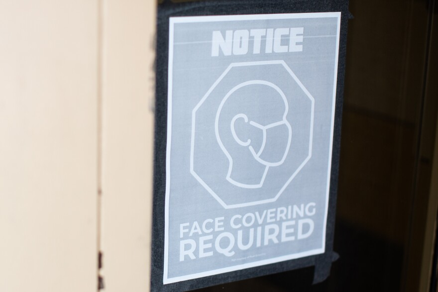 A sign at Galindo Elementary School in South Austin reminds people that face coverings are required.
