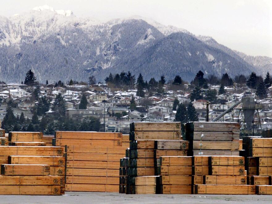 Piles of softwood lumber destined for export are stacked at a Canadian lumberyard in Richmond, British Columbia.