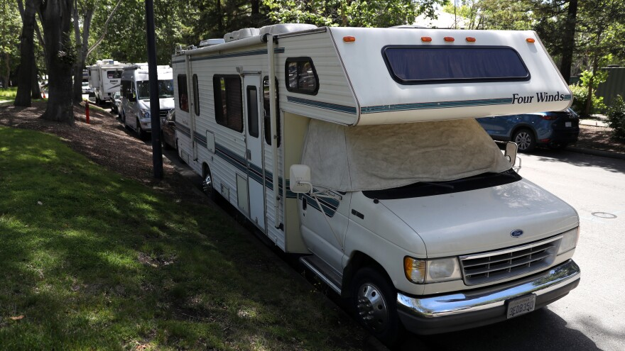 RVs sit parked on a street near Google's headquarters in Mountain View, Calif. Some longtime area residents and lower-paid Google workers have had to look for alternatives to paying steep rental costs.