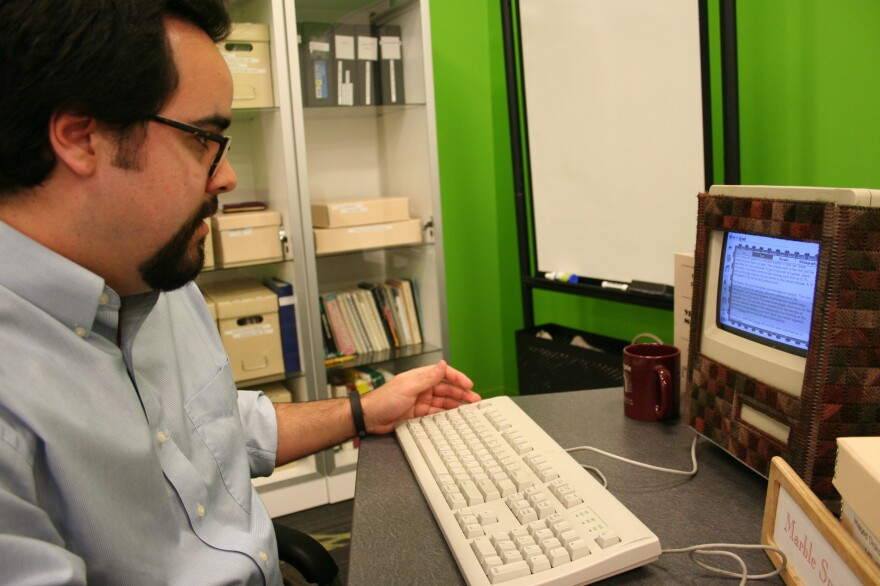 Trevor Muñoz, an associate director of the Maryland Institute for Technology in the Humanities, uses a Macintosh Classic II. The machine is the only way to access the work of Deena Larsen, a pioneer artist in the world of hypertext literature. (Larsen created a sweater of sorts for the computer to make it look more inviting.)