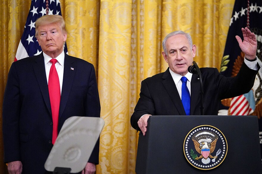 U.S. President Donald Trump and Israeli Prime Minister Benjamin Netanyahu take part in an announcement of Trump's Middle East peace plan in the East Room of the White House in Washington, D.C. on January 28, 2020. (MANDEL NGAN/AFP via Getty Images)