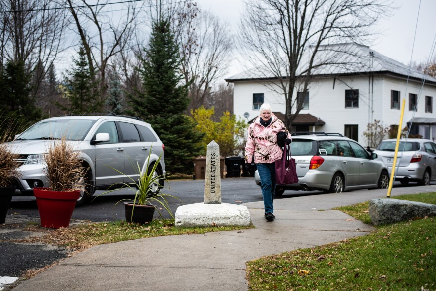 Ann Kasowski, of Stanstead, Quebec, crosses into the United States from Canada to enter the Haskell Free Library & Opera House. Kasowski said she lives four houses from the border.