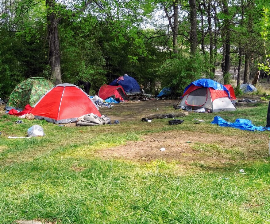 CMPD says the property owner asked to have this homeless encampment cleared Friday.