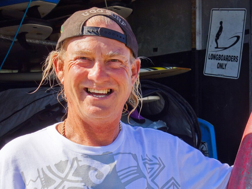 Michael Pless, an instructor at M&M Surfing School in Seal Beach, says he's been stung 21 times in the past 30 years.