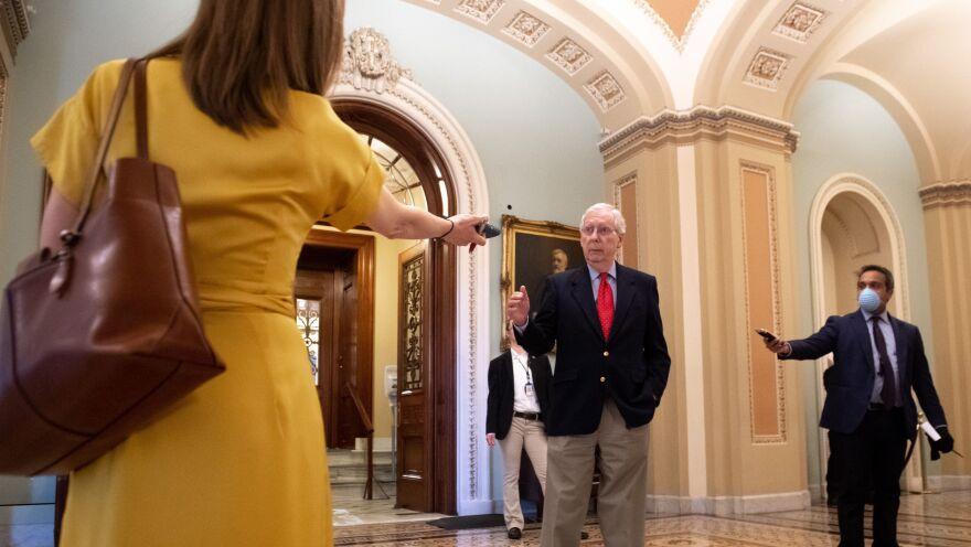 Senate Majority Leader Mitch McConnell speaks to reporters after leaving the Senate floor on April 9.