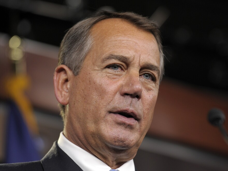 House Speaker John Boehner of Ohio holds a news conference on Capitol Hill on Friday.