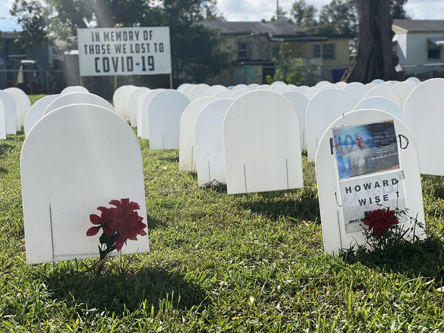A symbolic cemetery, in memory of neighborhood residents who have died from COVID-19, stands as a memorial in a field at Simonhoff Park in the Liberty City.