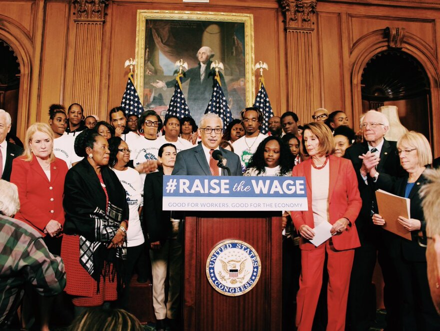 House Education and Labor Committee Chair Bobby Scott at the podium with Congressional Democrats and supporters of the wage increase.