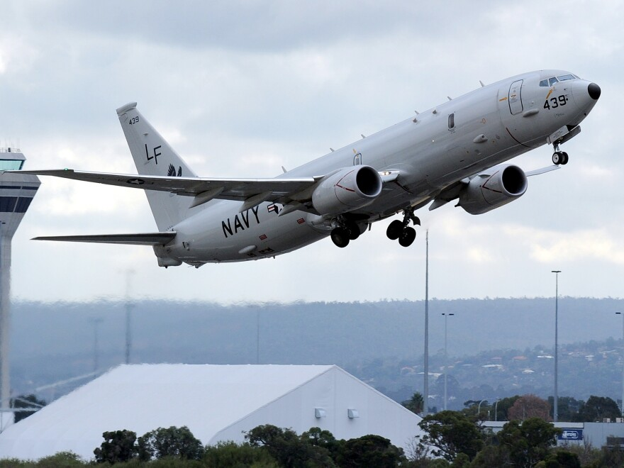 "A U.S. Navy P-8 Poseidon aircraft takes off from Perth International Airport during the search for Malaysia Airlines MH370. The same general type of aircraft was involved in a ""dangerous intercept"" by a Chinese fighter jet earlier this week off Hainan island."