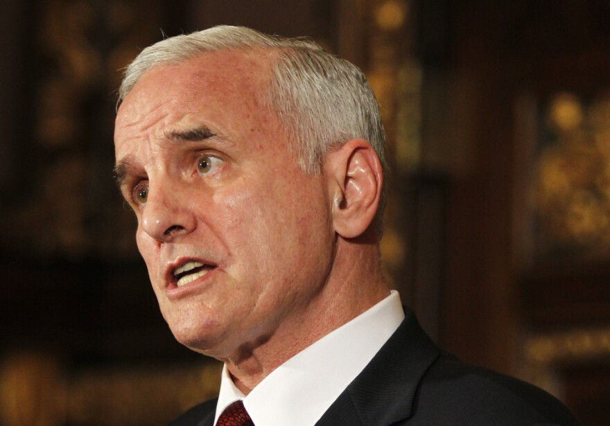 Gov. Mark Dayton speaks during a news conference hours before the government shut down.