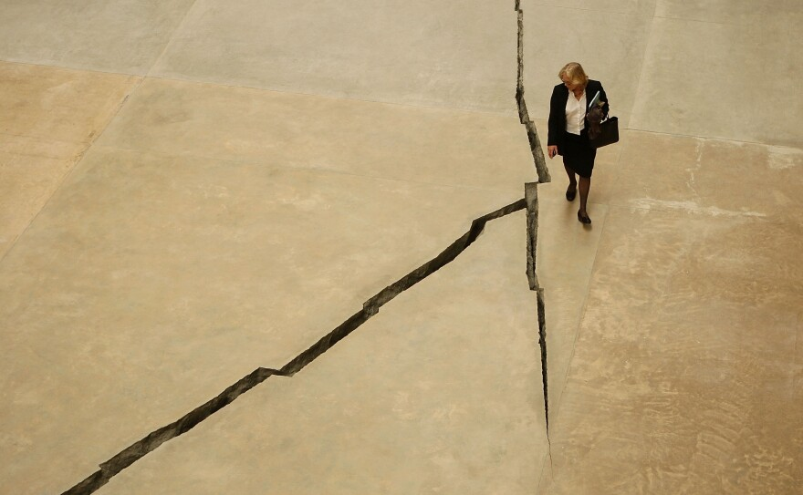 Salcedo's work <em>Shibboleth</em> is displayed at London's Tate Modern gallery in 2007. She opened up a snaking, nearly 550-foot-long crack in the concrete of the Turbine Hall.