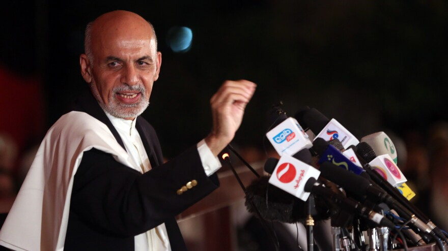 Afghan presidential candidate Ashraf Ghani speaks to the media at his residence in Kabul on June 25. Ghani finished second to Abdullah Abdullah in the first round of voting, but appears to be ahead in the runoff. Abdullah claims there was widespread fraud in the runoff voting.