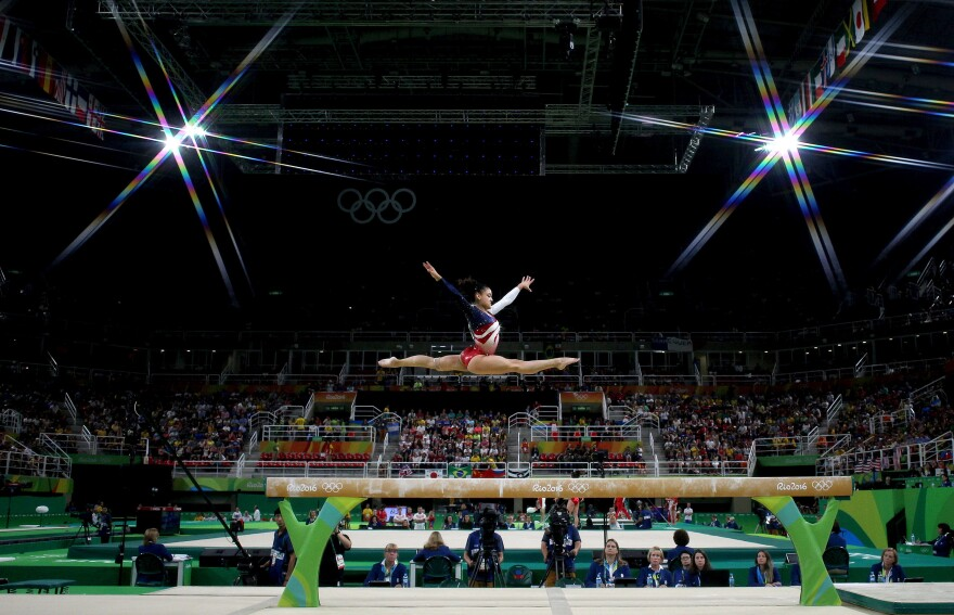 Lauren Hernandez of the United States performs on the balance beam during the women's team final.