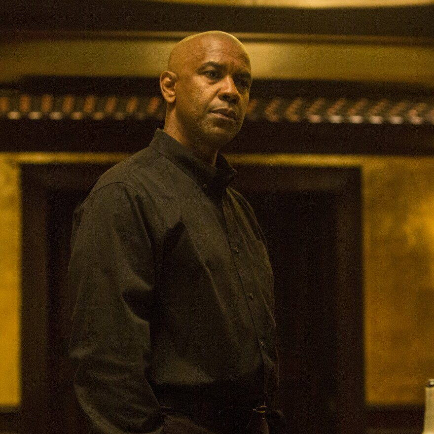 Denzel Washington stars as a retired intelligence officer in <em>The Equalizer</em>.