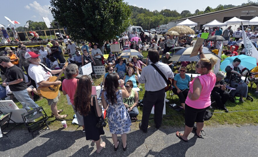 Musicians lead protesters in hymns outside the Carter County Detention Center in Grayson, Ky., on Tuesday.