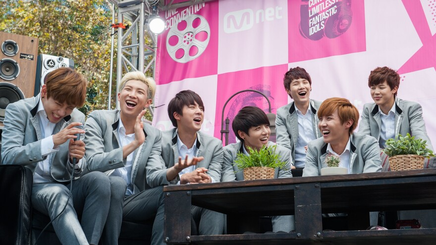 BTS, photographed during a presentation on Aug. 10 at KCON 2014 in Los Angeles, one year after the seven made their group debut.