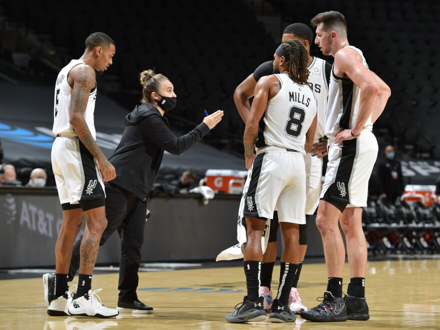 San Antonio Spurs assistant coach Becky Hammon made NBA history Wednesday, becoming the first woman to lead a team in the regular season. She's seen here talking to her players as they faced the Los Angeles Lakers at the AT&T Center in San Antonio, Texas.