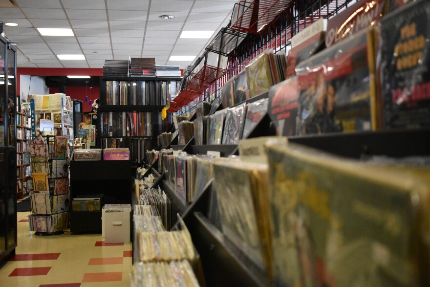 empty record store aisle with albums on one side