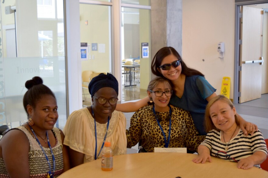 Disability activists from around the world attended a seminar in Oregon. From left, Joyce Peter of Vanuatu, Sidonie Nduwimana of Burundi,, Wendy Beatriz Caishpal Jaco of El Salvador, Gina Rose Balanlay of the Philippines (standing) and Raluca Oancea of Romania.