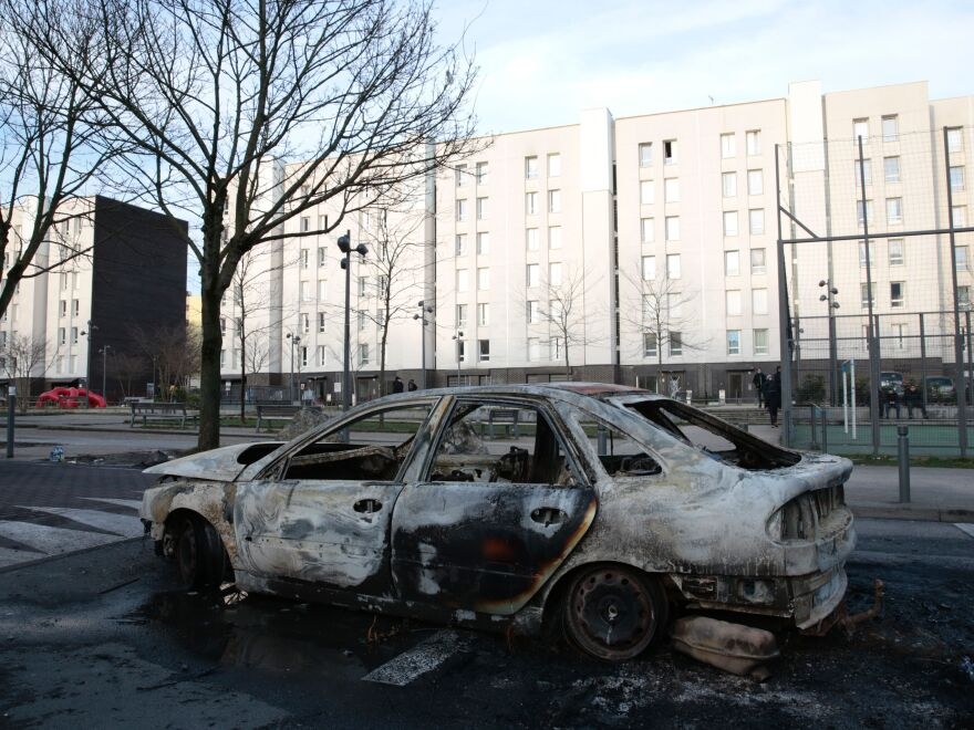 The wreckage of a car in one of the main streets of the Rose des Vents district in the Paris suburbs on Feb. 7.