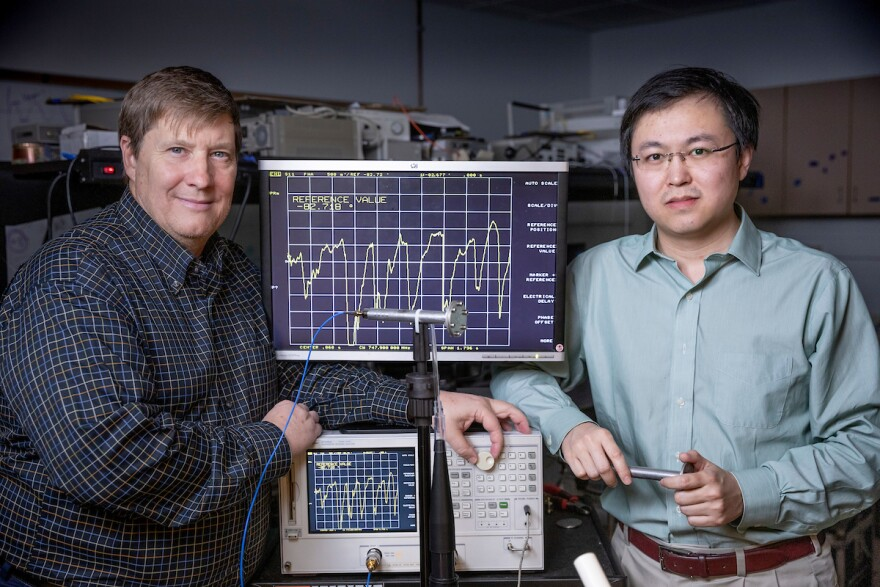 Missouri S&T professors Rex E. Gerald II and Jie Huang with the sensor they are developing that could help screen people for viruses like coronoavirus. Photo from Missouri S&T, provided March 2020