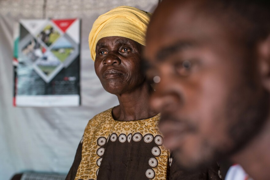 Odero with his mother, Pamela. With no income of his own, he's had to rely on her and other relatives.