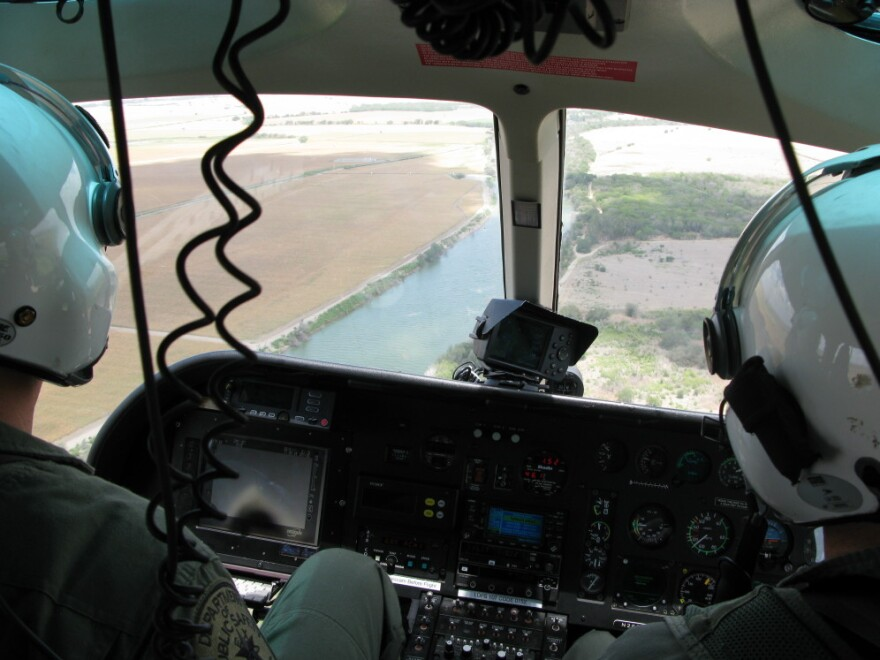 Texas Department of Public Safety pilots monitor the Rio Grande River near Los Ebanos, Texas.